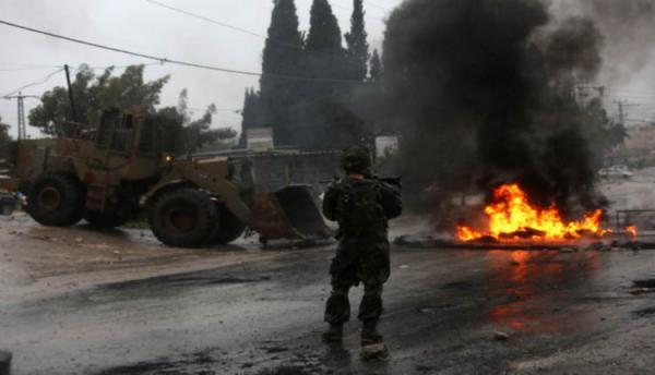 الاحتلال يصيب فلسطينيين في جنين ويعتقل 14مواطنا بالضفة